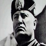 Being Mussolini.